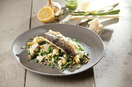 Grilled sea bass on a spring bed with pesto